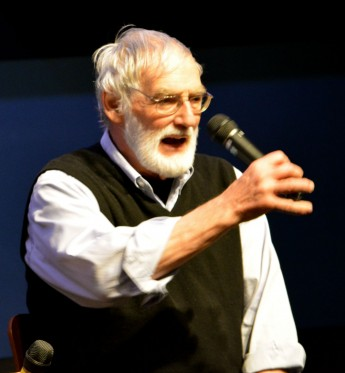 Dr. Dennis Meadows gestures with a microphone