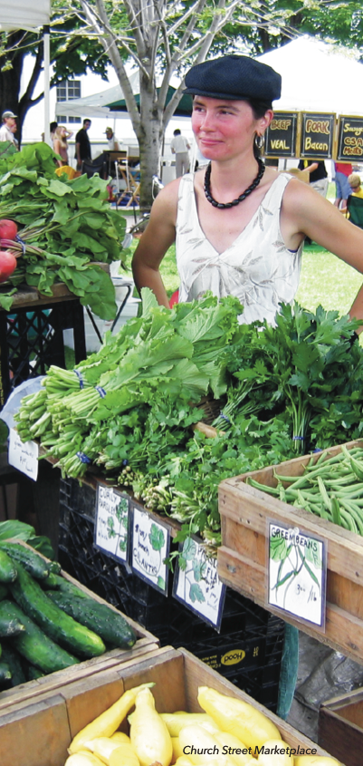Woman selling vegetables at a farmers market