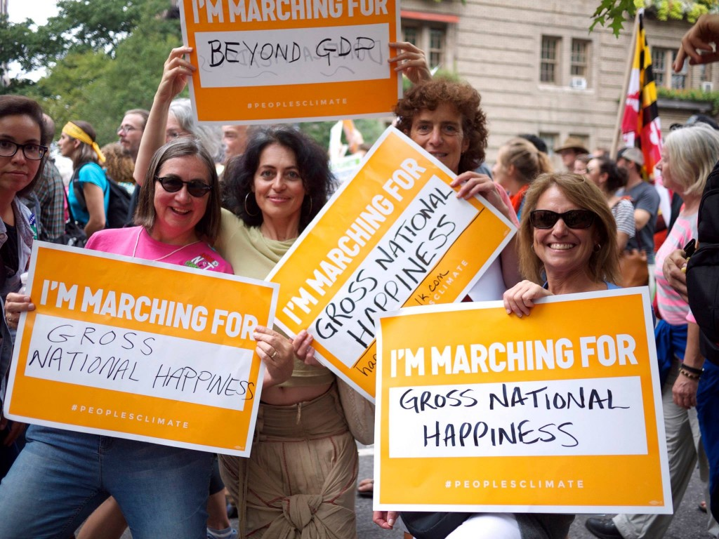 Meadows Institute Marta Ceroni with colleagues from Gross National Happiness USA at the climate march in NYC