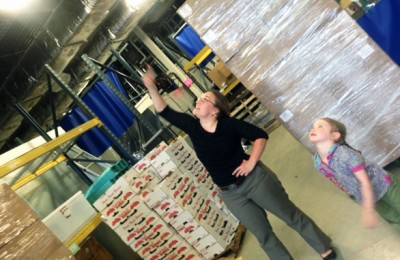 Woman and young girl touring a warehouse at the Center for an Agricultural Economy