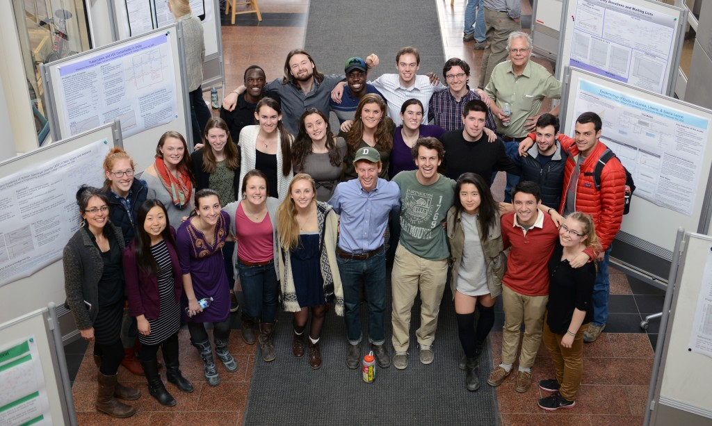 group shot of the class with their poster presentations